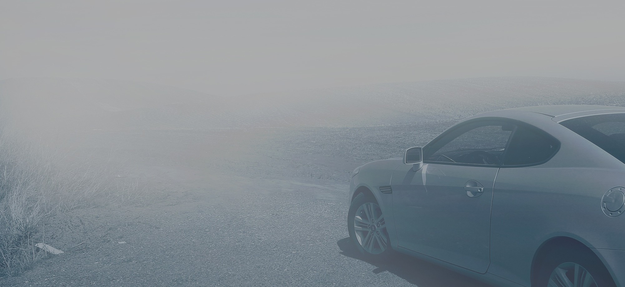Picture of a grey car on a foggy road, by Frantzou Fleurine.